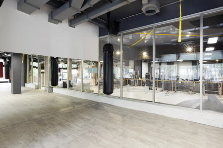 Punching bag in gym Stockfoto