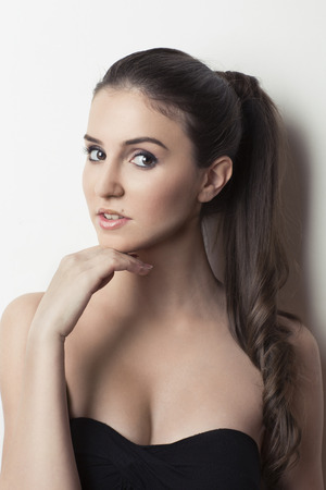 tube top: Beautiful girl with hand on chin