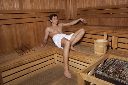 Handsome man relaxing in sauna