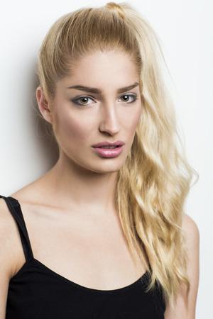spaghetti strap: Beautiful blonde woman with ponytail