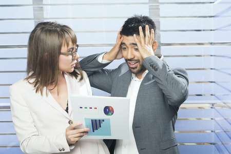 criticized: Frustrated businessman being criticized by manager Stock Photo