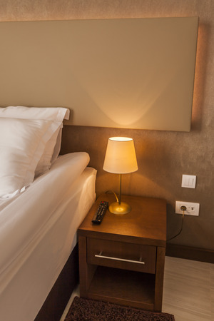 bedside lamp: Bedside lamp on night table