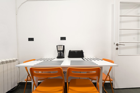 dining table and chairs: Dining table with four chairs in cheap apartment
