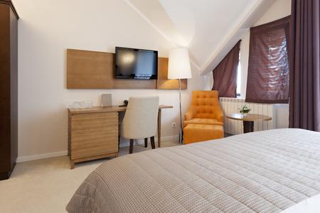 Elegant double bed hotel room photo