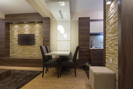 tv wall: Dining table in modern luxury apartment