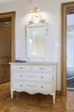 antique mirror: Antique mirror and cabinet in classic style room