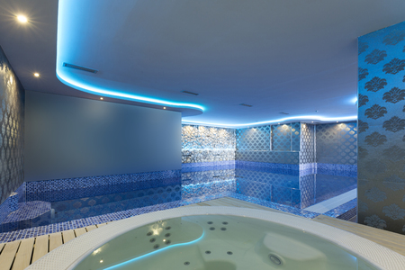 jacuzzi: Indoors pool and jacuzzi with colorful lights at spa center