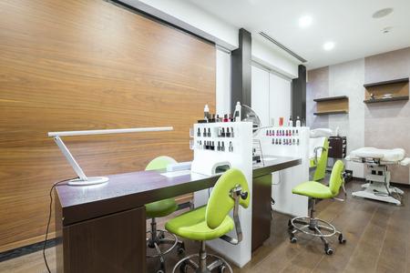 Manicure station at modern beauty salon