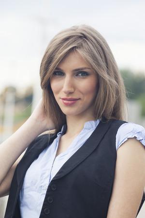 short sleeve: Beautiful woman in waistcoat and short sleeve shirt