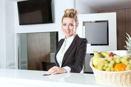 keycard: Beautiful hotel receptionist handing out key Stock Photo