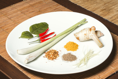 crushed red peppers: Basic ingredients for Thai cooking - kaffir lime leaves, chili peppers, lemongrass, crushed red pepper, curry, palm sugar, galangal root, papaya