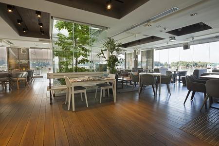 Interior of an elegant riverside cafe Stockfoto
