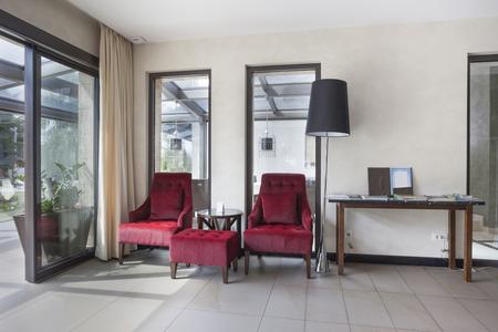 Armchairs in building corridor