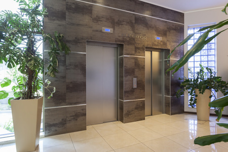 plant design: Two elevators in a modern building Stock Photo