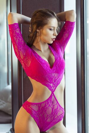 beautiful cleavage: Sexy woman in pink lingerie Stock Photo