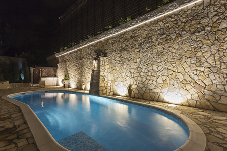 residential: Private swimming pool at night Stock Photo