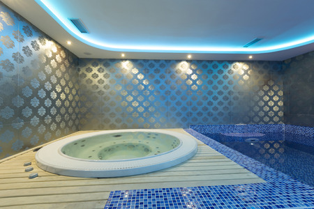 jacuzzi: Indoors jacuzzi and pool with colorful lights at spa center