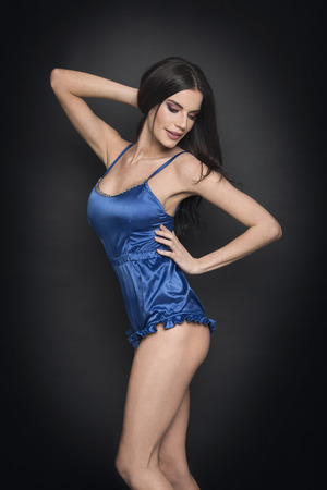 spaghetti strap: Beautiful woman posing in blue silk lingerie