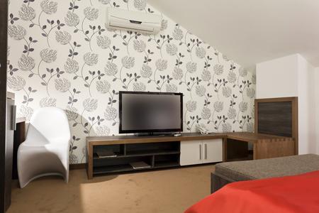 Tv in Modern bedroom photo