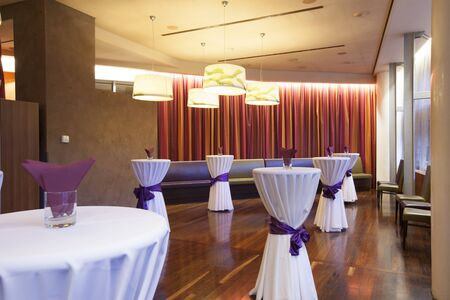 special occasions: Hall for special event with standing tables Stock Photo