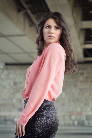 miniskirt: Young woman in pink shirt and black miniskirt Stock Photo