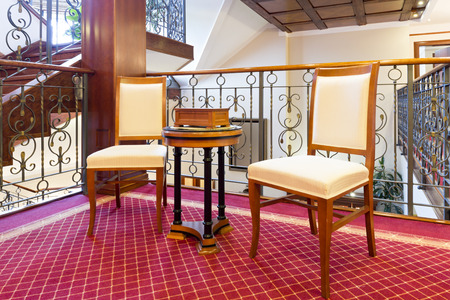 two chairs: Two chairs in hotel corridor Stock Photo