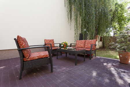 porches: Table and chairs on patio Stock Photo