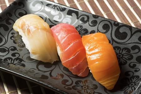 sake maki: Three nigiri sushi assortment - hamachi, maguro, sake