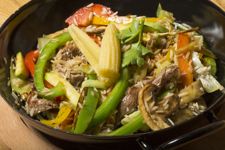 baby corn: Beef and baby corn stir fry asian fusion dish Stock Photo
