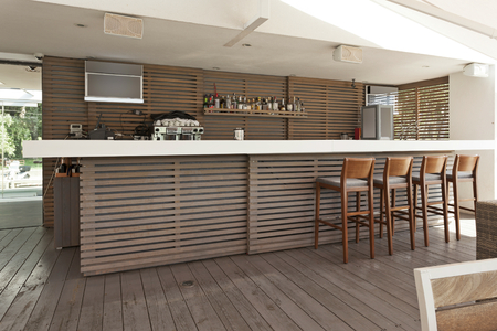 Wooden bar and chairs