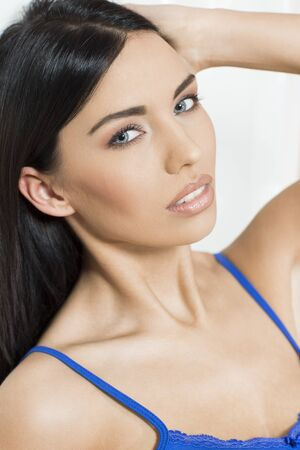 blue eyes: Beauty portrait of a woman with black hair and blue eyes
