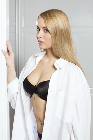 Attractive blonde woman in white shirt and bra Stock Photo - 40125190