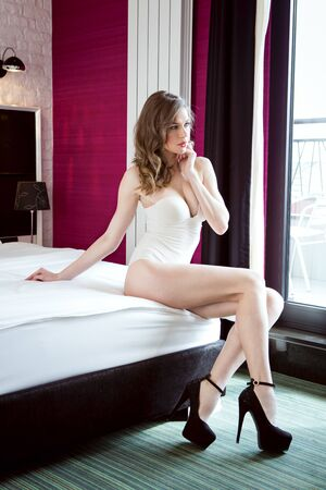 sittting: Beautiful woman sittting on bed in lingerie