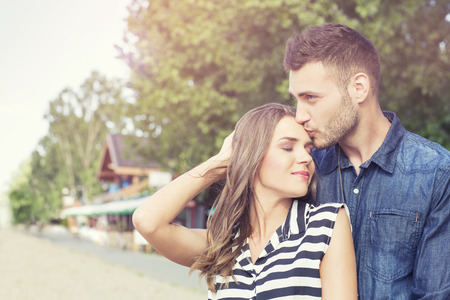 Young affectionate couple outdoors Stock Photo