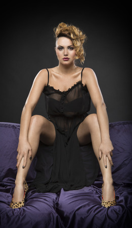 leopard print lingerie: Sexy woman posing on sofa