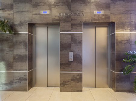 elevators: Two elevators in a modern building Stock Photo