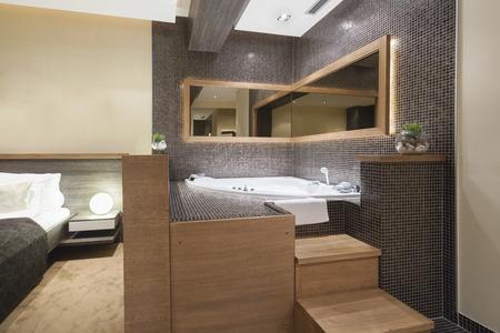 Modern open jacuzzi in bedroom