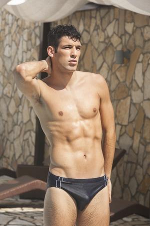 briefs: Handsome muscular man in swim briefs