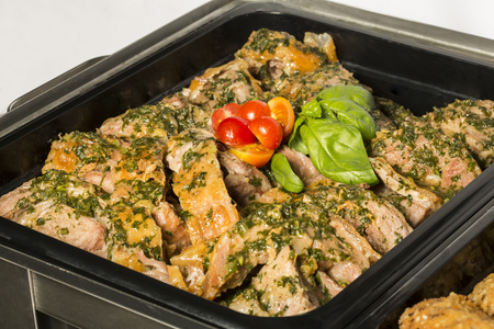 marinated: Delicious marinated pork in metal pan