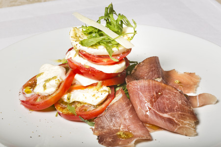 caprese: Caprese salad and prosciutto Stock Photo