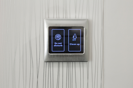 clean up: Do not disturb, clean up buttons in hotel room