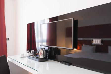 Desk and tv in modern hotel room Foto de archivo