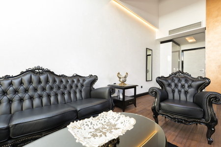 leather furniture: Elegant luxury living room with black leather furniture Stock Photo