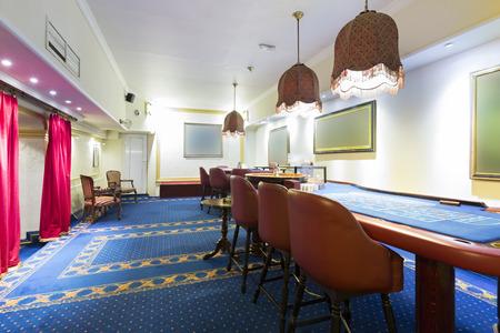 blackjack: Blackjack and roulette tables at casino