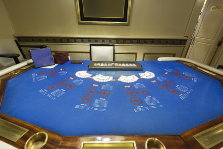 Ultimate texas holdem table at casino Stock Photo