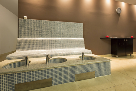 basins: Heated bench and foot basins in spa center Stock Photo