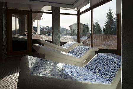 heated: Heated stone chairs at spa center