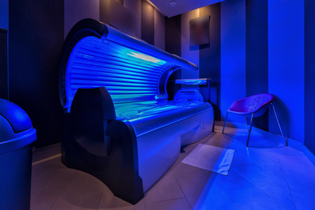 Modern sunbed in a beauty salon Фото со стока