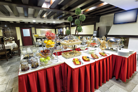 Hotel breakfast served on buffet table