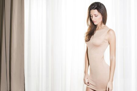 woman in dress: Portrait of a beautiful woman in beige dress